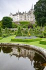 United Kingdom, Scotland, Highland, Golspie, In the gardens of Dunrobin Castle by pond — Stock Photo
