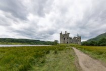 United Kingdom, Scotland, Argyll and Bute, Dalmally, Loch Awe, Kilchurn Castle from a distance, green fields landscape — Stock Photo