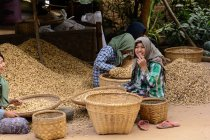 Myanmar, Mandalay Province, women working near baskets — Stock Photo