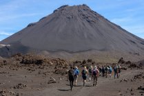 Cape Verde, Fogo, Santa Catarina, rear view of hikers on the way to volcano Fogo — Stock Photo