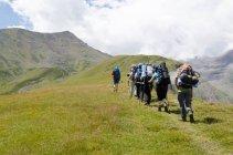 Georgia, Mzcheta-Mtianeti, Stepanzminda, Kazbegtour, people on way to Arsha Pass — Stock Photo