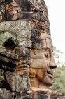 Camboja, província de Siem Reap, Krong Siem Reap, Angkor Thom, face esculpida em pedra — Fotografia de Stock