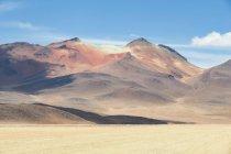 Bolivia, Departamento de Potosi, Nor Lopez, Salvador Dali Desert and scenic mountains view on background — Stock Photo