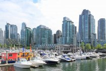 Canada, British Columbia, Vancouver, Private marina in Vancouver, modern architecture on background — Stock Photo