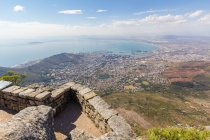 South Africa, Western Cape, Cape Town aerial view from Table Mountain National Park, cityscape by the ocean coast in sunshine — Stock Photo