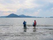 Two fishermen holding fishing net in water, Phang Nga, Thailand — Stock Photo