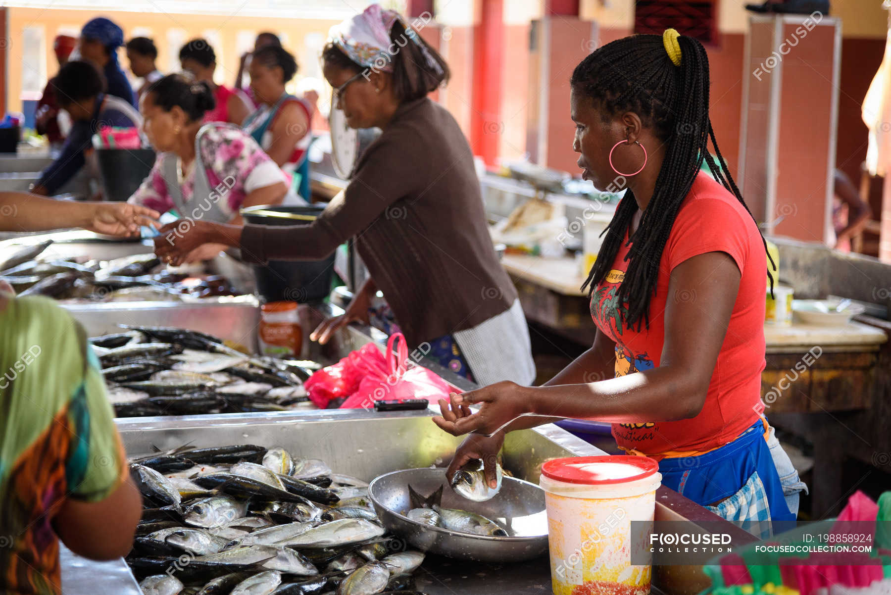 View of sellers and buyers street fish market of Mindelo, Sao