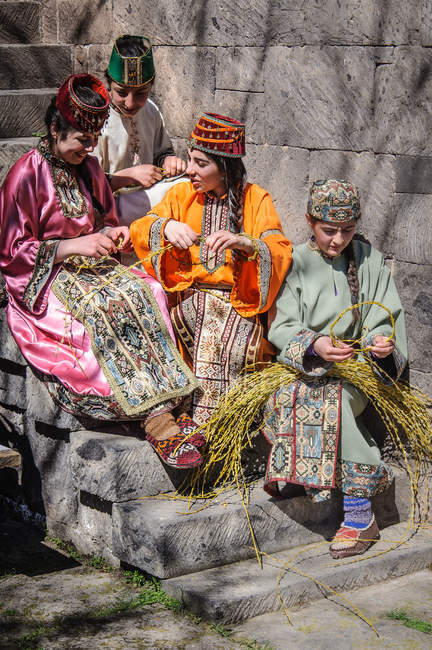 Women in traditional clothing preparations for Easter festival, Armenia — Stock Photo
