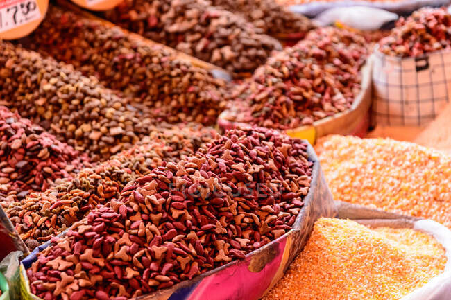 Arequipa Market stall with heaps of snacks and spices in market hall, Arequipa, Peru — Stock Photo