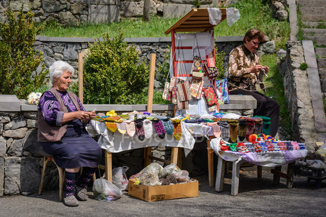 Two mature women selling knitted woolen socks and accessories, Haghpat Monastery, Haghpat, Lori Province, Armenia — Stock Photo