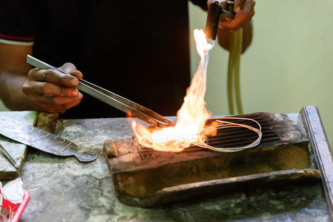 Midsection of silver forge male worker in Yogyakarta, Java, Indonesia, Asia — Stock Photo