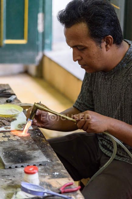 Silver forge male worker in Yogyakarta, Java, Indonesia, Asia — Stock Photo
