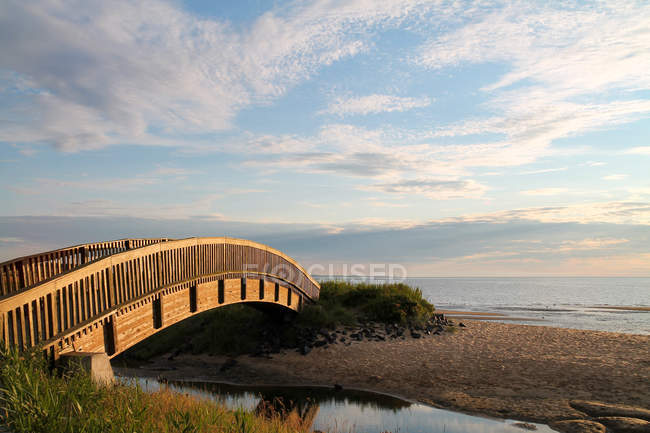 Germany, Schleswig-Holstein, Sylt, Keitum, bridge by the seashore at sunset — Stock Photo