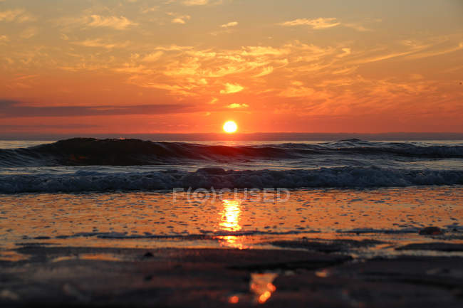 Germany, Schleswig-Holstein, Sylt, Kampen, Colorful sunset over the sea — Stock Photo
