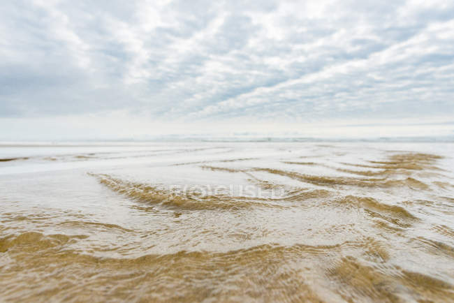 USA, Oregon, Cannon Beach, bedeckt über Sandstrand — Stockfoto