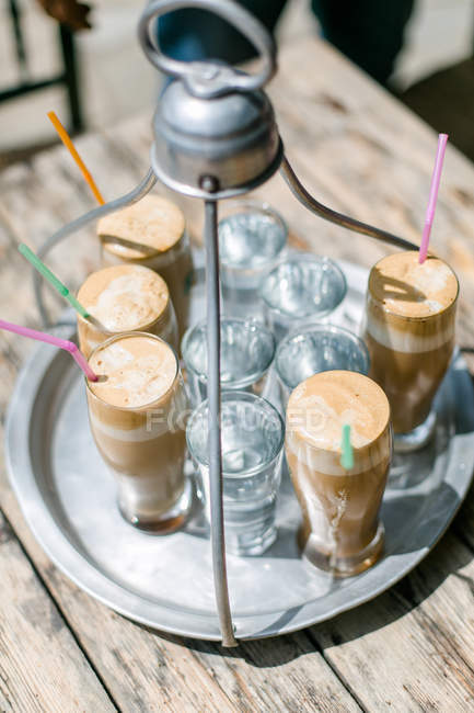 Tasty frappe coffee and cold water in high glasses in hot summer daytime at Kastro, Makedonia Thraki, Greece. — Stock Photo