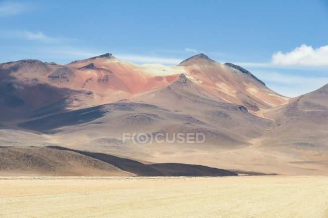 Bolivia, Departamento de Potosi, Nor Lopez, Salvador Dali Desert and scenic mountains view on background — стоковое фото