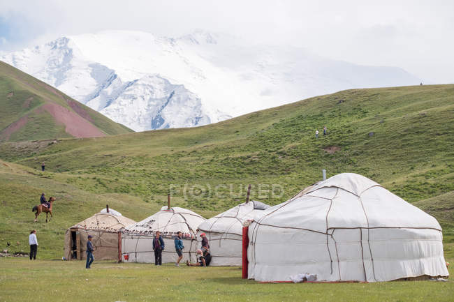 Kyrgyzstan, Osh region, yurt camp with Mt Lenin in the background — Stock Photo