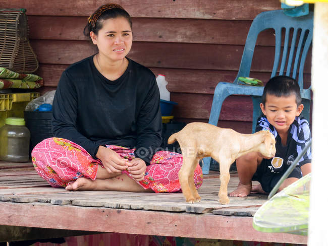 Mother with child and baby goat in village of Talaenok, Thailand — Stock Photo
