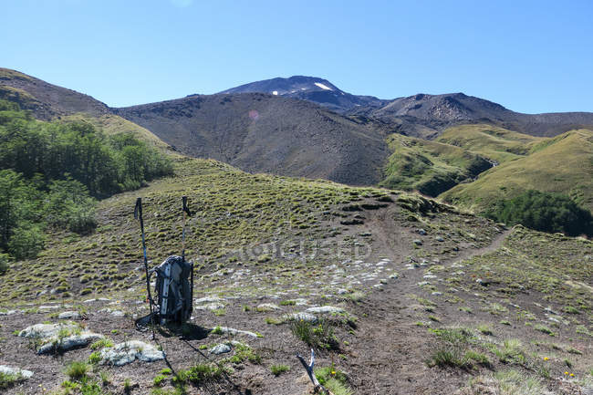 Chile, ascent of Quetrupillan volcano, backpack on mountain slope — Stock Photo