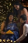 Woman with daughter and son  celebrating diwali — Stock Photo