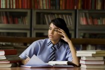 Girl in a school library — Stock Photo