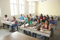 College students sitting in classroom — Stock Photo