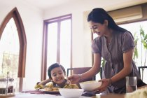 Mother putting food — Stock Photo