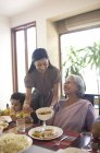 Woman serving her mother in law — Stock Photo