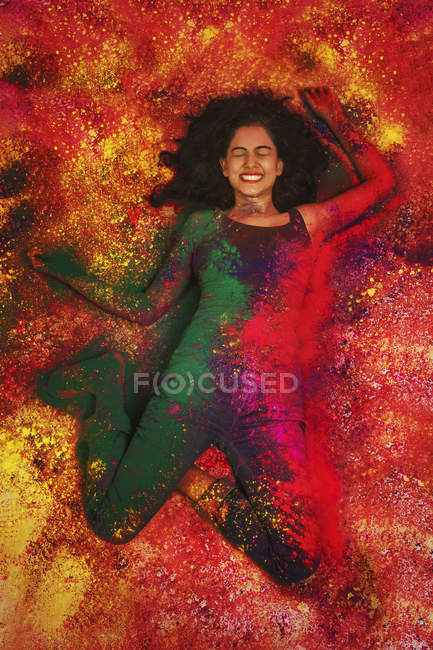 Girl   covered in colored powder — Stock Photo