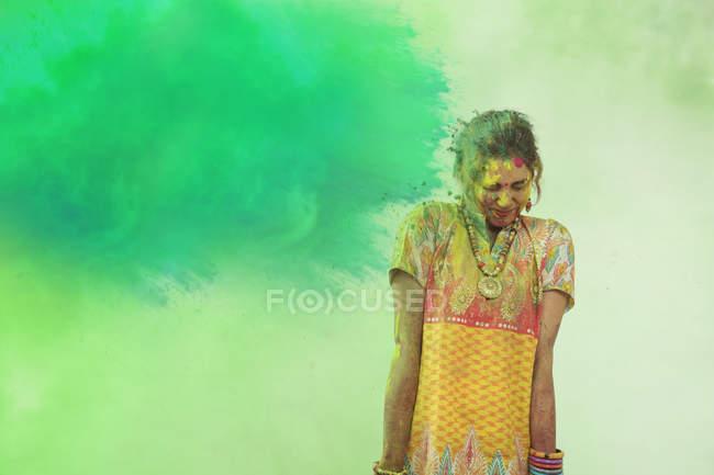 Woman celebrating Holi color festival — Stock Photo