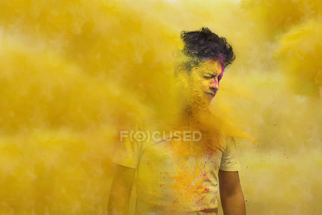 Man with holi colors — Stock Photo