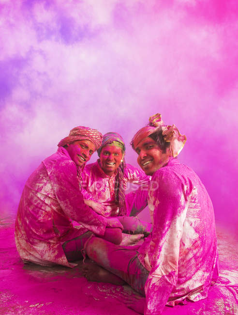 Men scovered in colored powder — Stock Photo