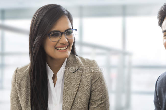 Indian businesswoman smiling — Stock Photo