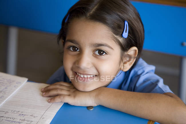 School girl at her desk — Stock Photo
