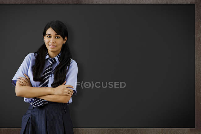 Girl  in front of a blackboard — Stock Photo