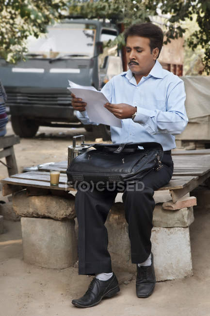 Salesman examining his paperwork — Stock Photo