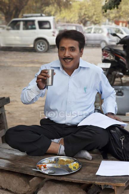 Salesman drinking water — Stock Photo