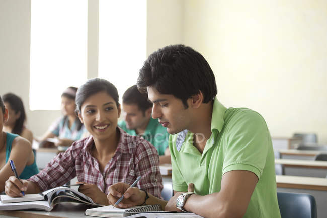Students studying in classroom — Stock Photo