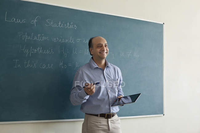 Professor holding a digital tablet — Stock Photo