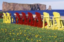 Perce Rock with colorful lawn chairs, Gaspe Peninsula, Quebec, Canada. — Stock Photo