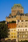 Chateau Frontenac with classic buildings on street in morning light, Quebec, Canada. — Stock Photo