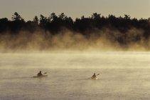 Young couple sea kayaking on Lake Rosseau, Muskoka, Ontario, Canada. — Stock Photo