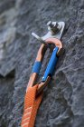 Quickdraw climbing equipment on rock, close-up — Stock Photo