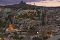 Townscape and fairy chimneys of Goreme at sunset, Cappadocia, Turkey — Stock Photo