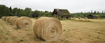 Harvested hay field with rustic old buildings in Cariboo, British Columbia, Canada — Stock Photo