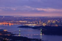 Vancouver skyline with Lion Gate Bridge and Burrard Inlet at dawn, British Columbia, Canada. — Stock Photo