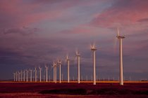 Power-generating windmills operating at dawn near Fort Macleod, Alberta, Canada. — Stock Photo