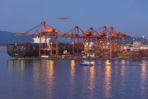 Port of Vancouver, cranes and freighter at dusk, British Columbia, Canada. — Stock Photo