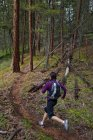 Woman trail running in forest of Penticton, British Columbia, Canada — Stock Photo